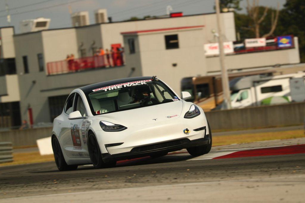 John Laughlin Tesla Model 3 road course curb