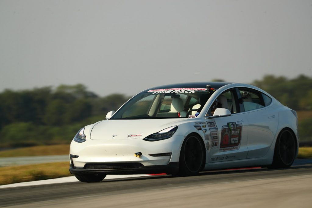 John Laughlin Tesla Model 3 road course dark